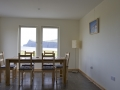 Holiday cottage on Skye with eat-in kitchen and sea view.
